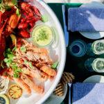 Populære corona-sikrede drivhusrestauranter forlænges med seafood-koncept